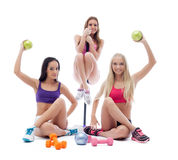 Funny sportswomen posing with sports equipment Royalty Free Stock Photo