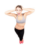 Funny sporty woman beauty looking at camera surprised Royalty Free Stock Photo