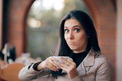 Funny Squeamish Girl with Hot Chocolate Drink. Demanding client unpleased discovering caffeine intolerance stock image