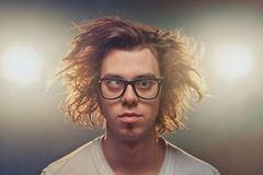 Funny Squinting man with Tousled brown hair in studio Stock Images