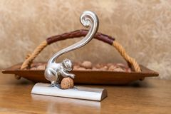 Nutcracker and wooden basket with nuts stock images