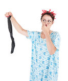 Funny stereotypical housewife with man sock bad smell Stock Photography