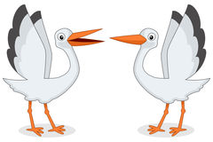 Funny Storks with Outstretched Wings Stock Photo