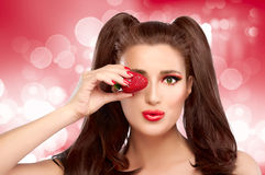 Funny with Strawberry in Eye Royalty Free Stock Photo