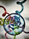 Funny straws. Multicolour straws in a blue glass Stock Photography