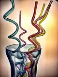 Funny straws. Funny shape and multicoloured straws in a glass Royalty Free Stock Photography