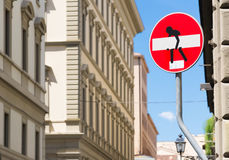 Funny street sign with a man that carrying a white board. A piece of art on a red sign Stock Photography