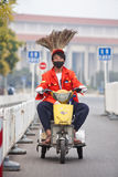 Funny street sweeper on a small electric tricycle, Beijing, China. BEIJING-JUNE 1, 2015. Funny street sweeper on an electric trike. Thanks to an army of street Stock Images