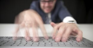 Funny stressed businessman typing fast on the computer keyboard, time lapse video