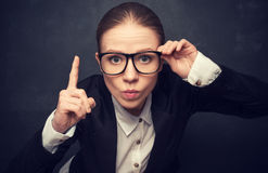 Funny strict teacher with glasses. Shakes his finger at the school board Royalty Free Stock Image