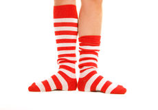 Funny striped socks. Funny striped red socks isolated on white Stock Photography