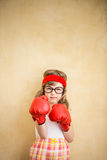Funny strong child. Girl power and feminism concept stock image