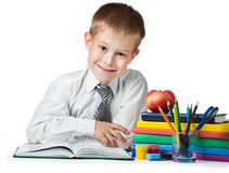 Funny student with books and pencils Royalty Free Stock Photo