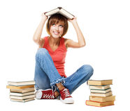 Funny student girl with lot of books Royalty Free Stock Photo