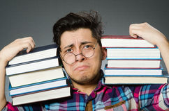 Funny student with many books Royalty Free Stock Images