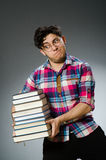 Funny student with many books Royalty Free Stock Image