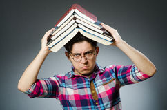 Funny student with many books Stock Images