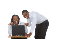 Funny stuff #1. Young Couple by laptop laughing Royalty Free Stock Images