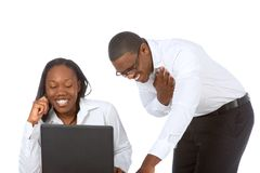 Funny stuff #2. African-American young Couple by laptop laughing Stock Image