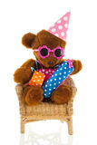 Funny stuffed bear with gifts Royalty Free Stock Photos