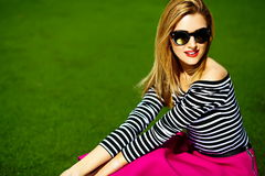 Funny stylish beautiful blond young woman model in hipster cloth Royalty Free Stock Photography