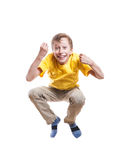 Funny stylish child jumping and laughing Royalty Free Stock Photo