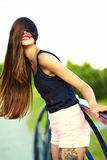 Funny stylish model girl in casual hipster cloth in the street Stock Photos