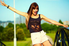Funny stylish model girl in casual hipster cloth in the street Stock Images
