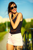 Funny stylish model girl in casual hipster cloth in the street Royalty Free Stock Photo