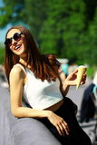 Funny stylish model girl in casual hipster cloth in the street Stock Image