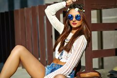Young hippie woman model in summer sunny day in bright colorful hipster clothes. Funny stylish sexy smiling beautiful young hippie woman model in summer white Stock Image