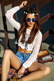 Young hippie woman model in summer sunny day in bright colorful hipster clothes. Funny stylish sexy smiling beautiful young hippie woman model in summer white Stock Photos