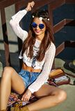 Young hippie woman model in summer sunny day in bright colorful hipster clothes. Funny stylish sexy smiling beautiful young hippie woman model in summer white Royalty Free Stock Photography