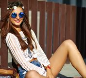 Young hippie woman model in summer sunny day in bright colorful hipster clothes. Funny stylish sexy smiling beautiful young hippie woman model in summer white Stock Images