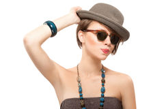 Funny summer girl in hat. Funny summer portrait of beautiful girl in sunglasses, holding her hat with hand, isolated Stock Photos