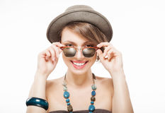 Funny summer portrait of girl. In hat, holding sunglasses with hands Stock Photos