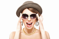 Funny summer portrait of girl. In hat, holding sunglasses with hands Royalty Free Stock Image
