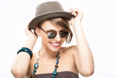 Funny summer portrait of girl. In sunglasses, holding her hat with hands Royalty Free Stock Photo