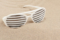 Funny sun glasses in sand Royalty Free Stock Image