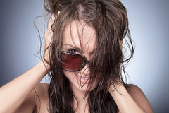 Funny sun glasses woman with gray background Stock Images
