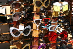 Funny Sunglasses Display. A variety of funky different sunglasses on display in a store Stock Photo