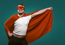 Free Funny Super Hero Man Ready To Fly Save World. Smiling Man In Mask And Red Superhero Costume Holding His Cloak In His Stock Image - 182147641