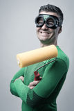 Funny superhero with painting roller Royalty Free Stock Images