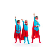 Funny superheroes. Dreamers. Funny superheroes. Children playing superheroes  isolated. Dreamers Royalty Free Stock Photos