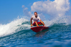 Surfing a wave. Funny surfer in action on a wave royalty free stock images