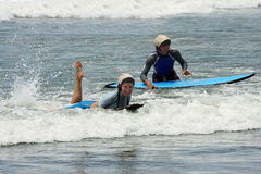 Funny surfing and body drag. On bali island Royalty Free Stock Photos