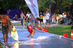 Funny surfing in city park. Young mеn surfing on water trail  on the lawn in Varna city park during the annual youth festival Fun city,Photo taken on August 29 Royalty Free Stock Photography