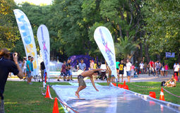 Funny surfing in city park. Young man surfing on water trail  on the grass in Varna city park during the annual youth festival Fun city,Photo taken on August 29 Stock Images