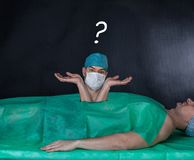 Funny surgery operation on a black background. Stock Photos