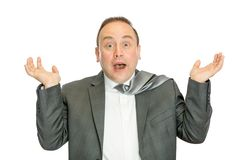 Funny, surprised business man in suit shrugging royalty free stock photo